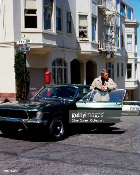 American actor Steve McQueen as Frank Bullit next to a Ford Mustang 390 GT 2+2 Fastback in the american crime thriller movie 'Bullitt', San...