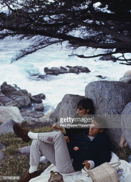 American actor Steve McQueen enjoying a picnic by the coast with his first wife actress Neile Adams 1965 McQueen has a bandaged left hand