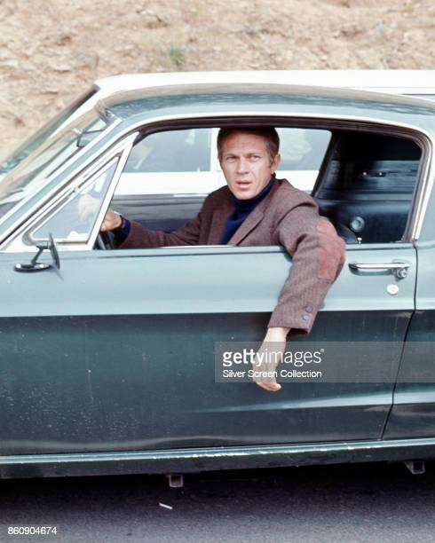 American actor Steve McQueen hangs his arm out the driverside window of a car in a scene from 'Bullitt' , California, 1968.