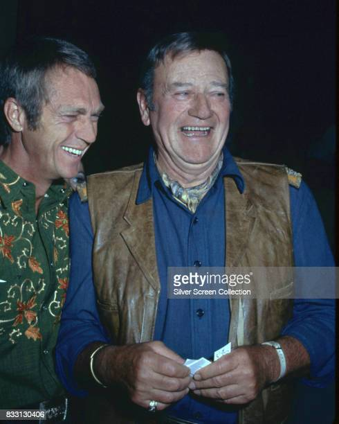 American actor Steve McQueen laughs with American actor John Wayne Los Angeles 1969