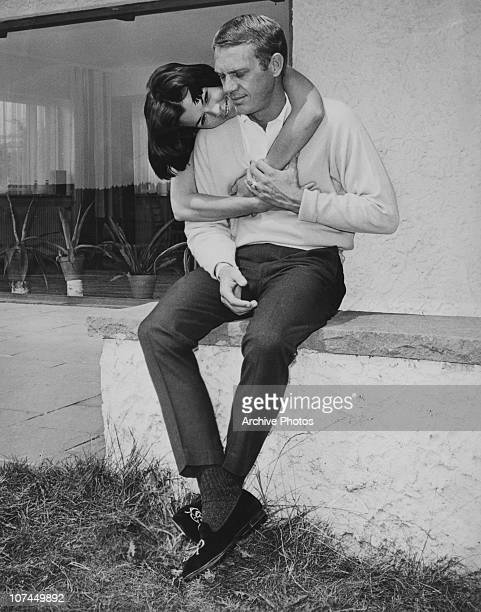 American actor Steve McQueen receives an embrace from his first wife actress Neile Adams circa 1965