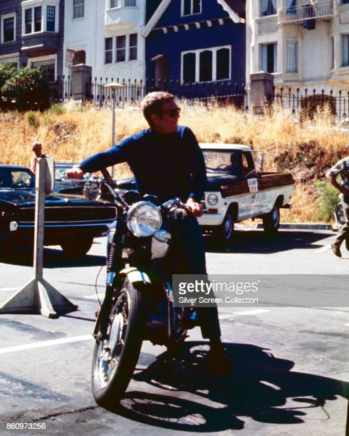 American actor Steve McQueen sits on a motorcycle on the set of 'Bullitt' California 1968