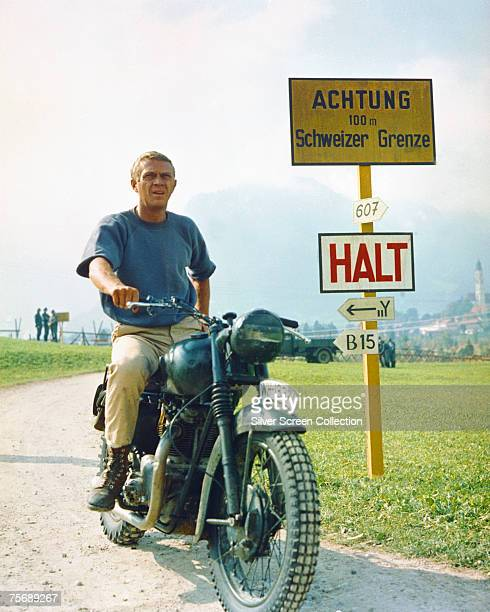 American actor Steve McQueen stars as Captain Virgil 'The Cooler King' Hilts in World War II drama 'The Great Escape', 1963. Here he poses on his...