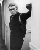 American actor steve mcqueen wearing a gun holster leans in a hallway picture id1682675?s=170x170