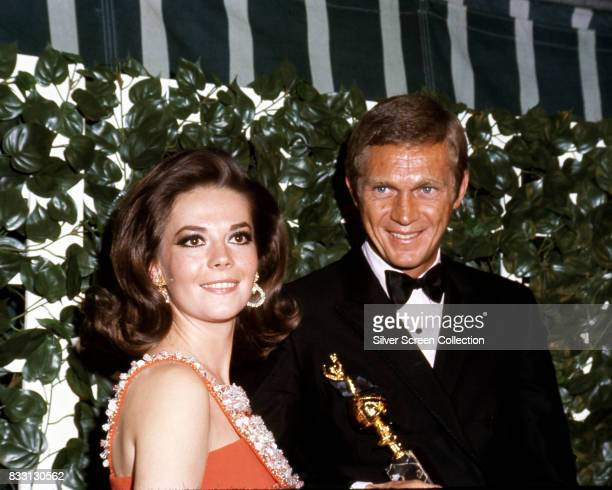 American actor Steve McQueen winner of the 'Henrietta Award for World Film FavoriteMale' with Natalie Wood at the 24th Annual Golden Globe Awards at...