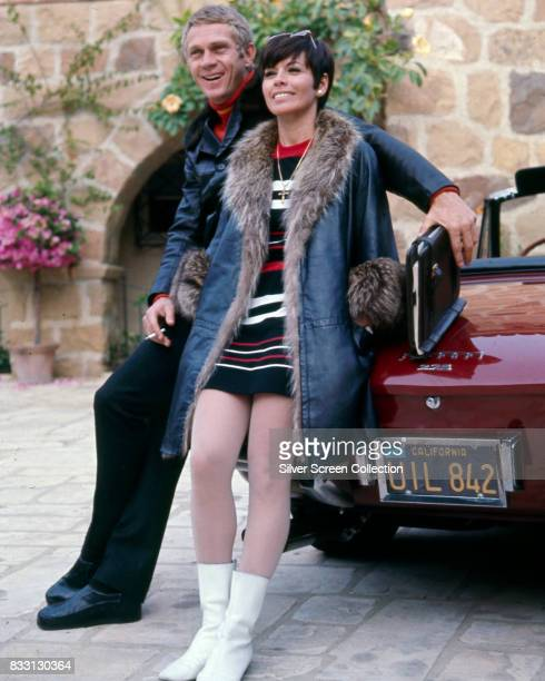 American actor Steve McQueen with his wife Filipinoamerican actress Neile Adams sitting on a Ferrari 275 Cabriolet Beverly Hills 1970