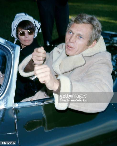 American actor Steve McQueen with his wife Filipinoamerican actress Neile Adams in a convertible sport car circa 1965