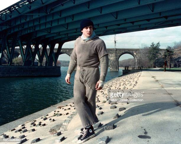 American actor Sylvester Stallone as Rocky Balboa during the filming of the training montage for the boxing film 'Rocky' 1976 He is standing by the...