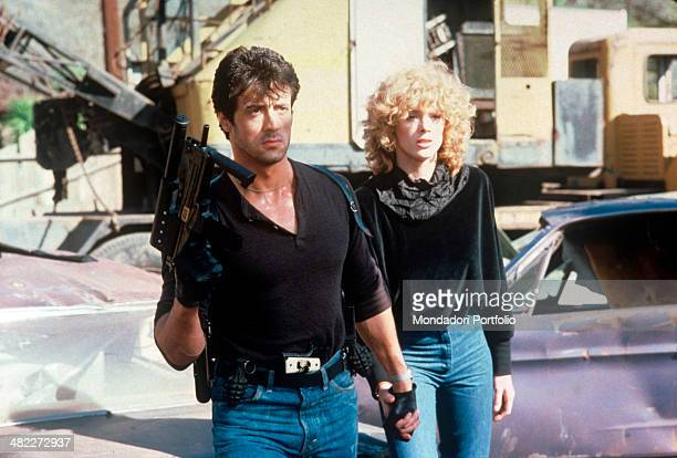 American actor Sylvester Stallone holding by her hand Danish actress Brigitte Nielsen in the film Cobra USA 1986
