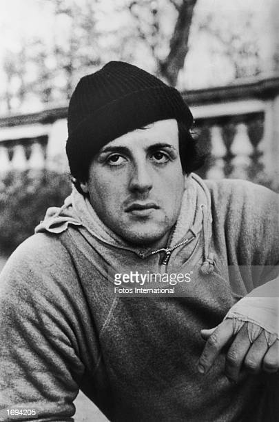 American actor Sylvester Stallone wears a knit hat sweatshirts and bandages around his fists in a still from the film 'Rocky' directed by John G...