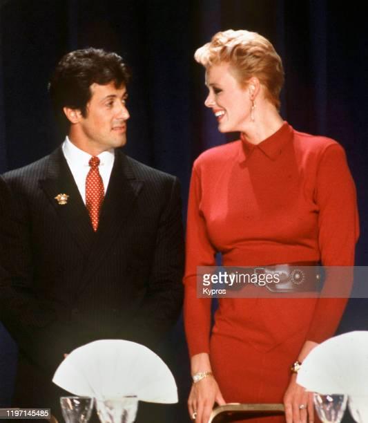 American actor Sylvester Stallone with his wife, actress Brigitte Nielsen, circa 1986.