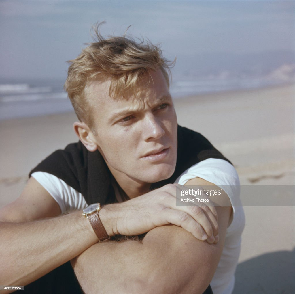 American actor Tab Hunter on a beach, circa 1955.