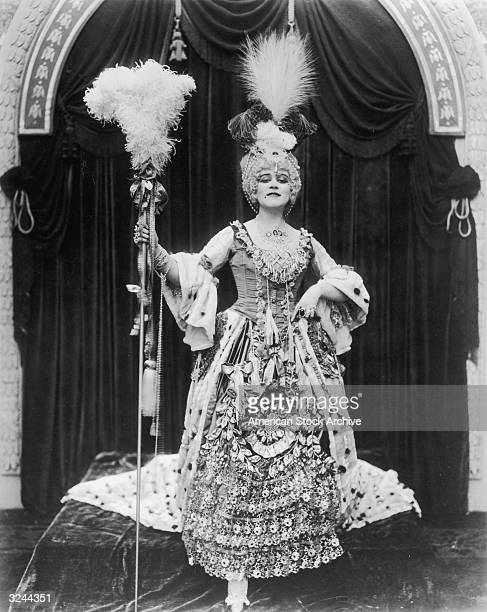 American actor Theda Bara poses in costume as Madame Du Barry in a promotional portrait from director J Gordon Edwards's film 'Madame Du Barry'