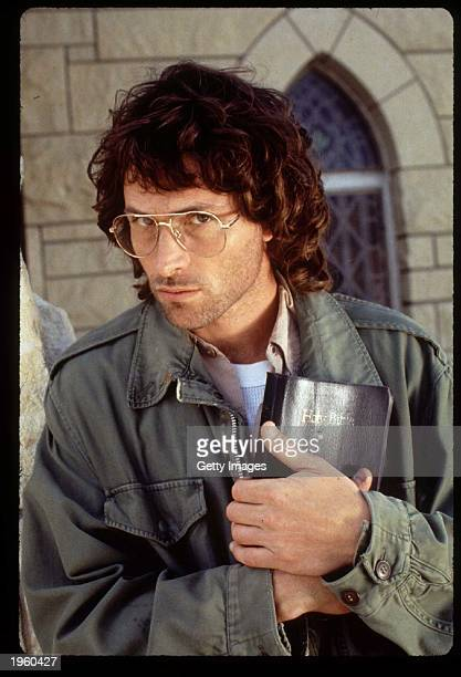 American actor Tim Daly holds a Bible close to his chest on the set of the TV movie 'In the line of fire Ambush in Waco' on location Tulsa Oklahoma...