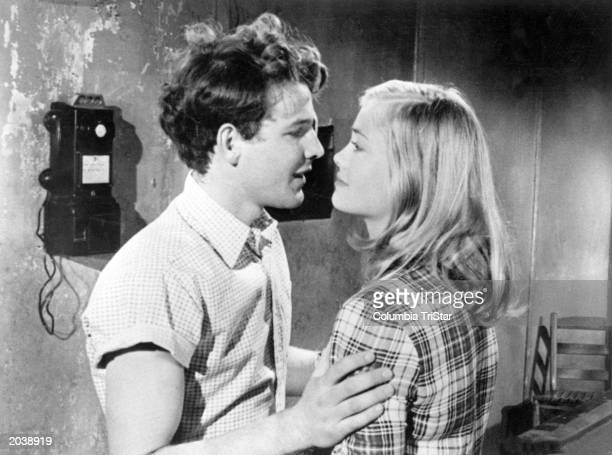 American actor Timothy Bottoms embraces American actress Cybill Shepherd in a still from the film 'The Last Picture Show' directed by Peter...