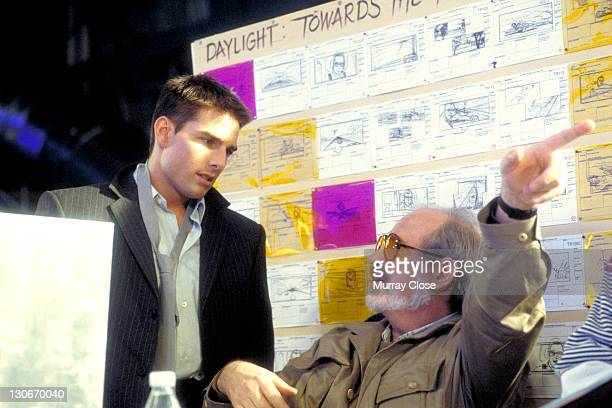 American actor Tom Cruise and director Brian De Palma on the set of the film 'Mission Impossible' 1996 Behind them are various storyboard...