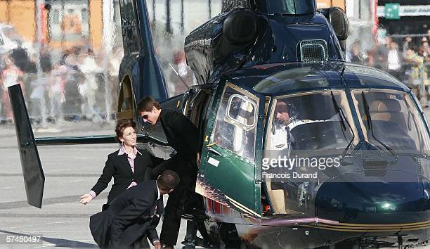 American actor Tom Cruise arrives by helicopter at the 'Mission Impossible III' French Premiere on April 26 2006 in La Defense outside Paris France