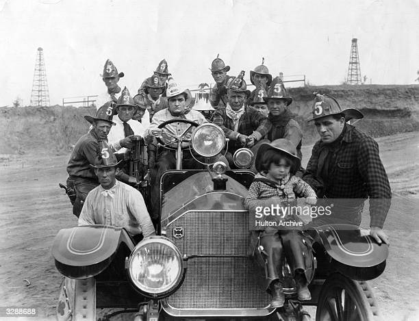 American actor Tom Mix at the wheel of a fire engine during a break in filming Lewis Seiler's 1927 silent western 'The Last Trail' in Los Angeles...