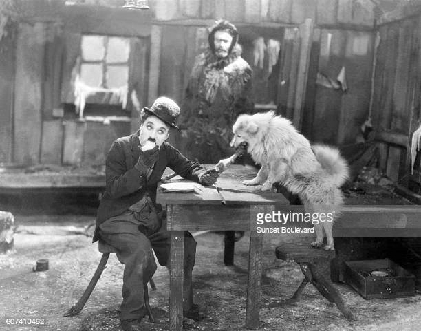 American actor Tom Murray with British actor director screenwriter and producer Sir Charles Spencer Charlie Chaplin on the set of his movie The Gold...