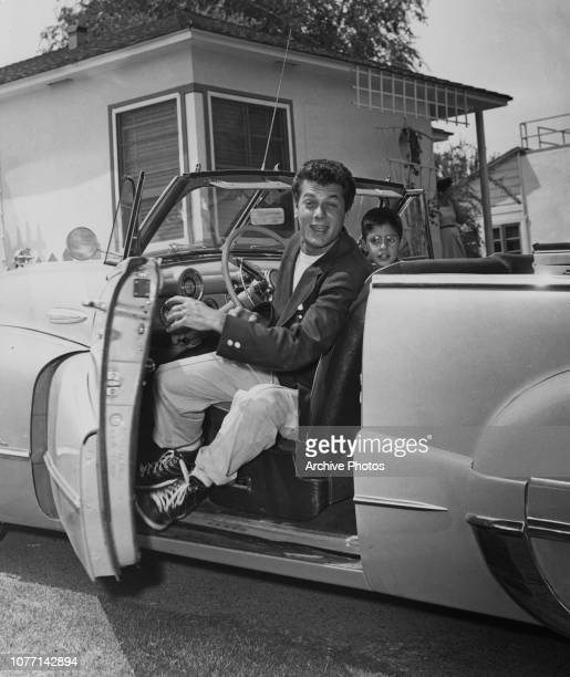 American actor Tony Curtis driving his Buick convertible with his younger brother Robert 1951