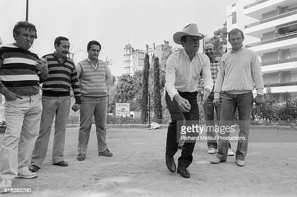 American actor Tony Curtis plays a round of boules while in France attending Cannes Film Festival. He is promoting his 1985 film, Insignificance,...
