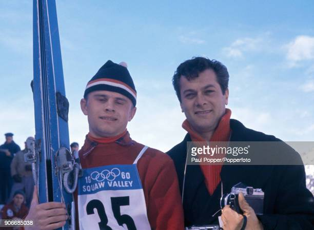 American actor Tony Curtis posing with skijumper Tamas Sudar of Hungary during the 1960 Winter Olympic Games at Squaw Valley in California 20th...