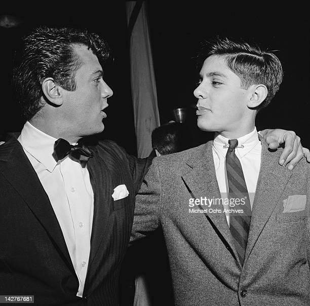 American actor Tony Curtis with his teenage brother Robert at the premiere of the film 'Trapeze' USA 29th May 1956