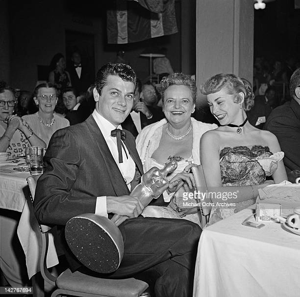 American actor Tony Curtis with his wife, actress Janet Leigh and his Henrietta award at the Foreign Press Association of Hollywood's First Annual...