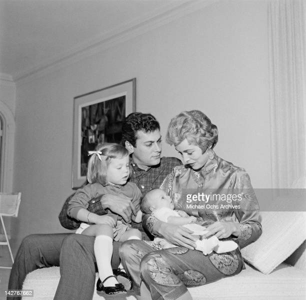 American actor Tony Curtis with his wife actress Janet Leigh and their daughters Kelly Curtis and baby Jamie Lee Curtis 1958