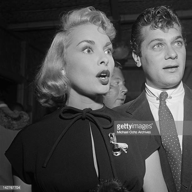 American actor Tony Curtis with his wife actress Janet Leigh during cocktails at the Hollywood Press Club Los Angeles 26th October 1953