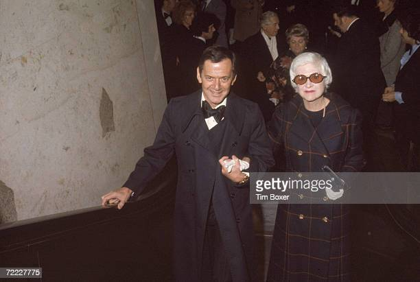 American actor Tony Randall climbs a staircase with his wife, model Florence climb a staircase at the National Theatre where they attend th eopening...