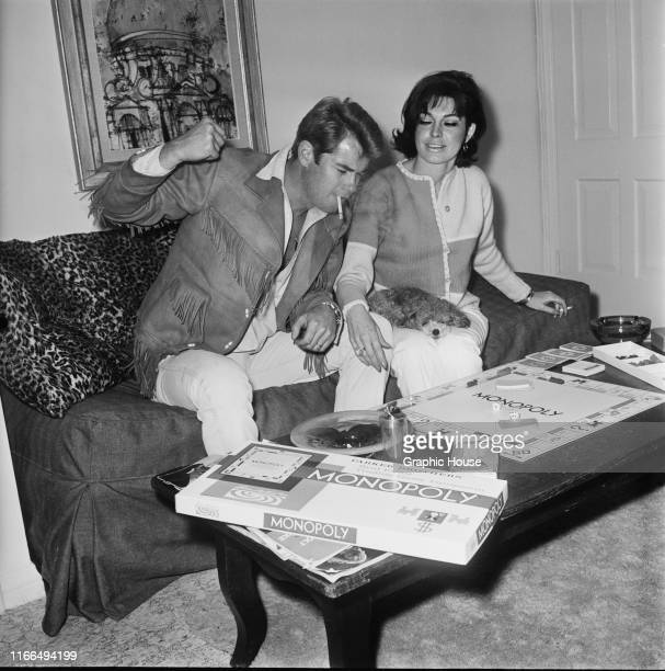 American actor Troy Donahue playing Monopoly at home in Beverly Hills California with his wife Valerie Allen circa 1967
