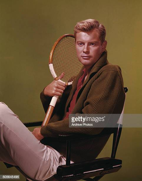 American actor Troy Donahue poses with a tennis racquet circa 1960