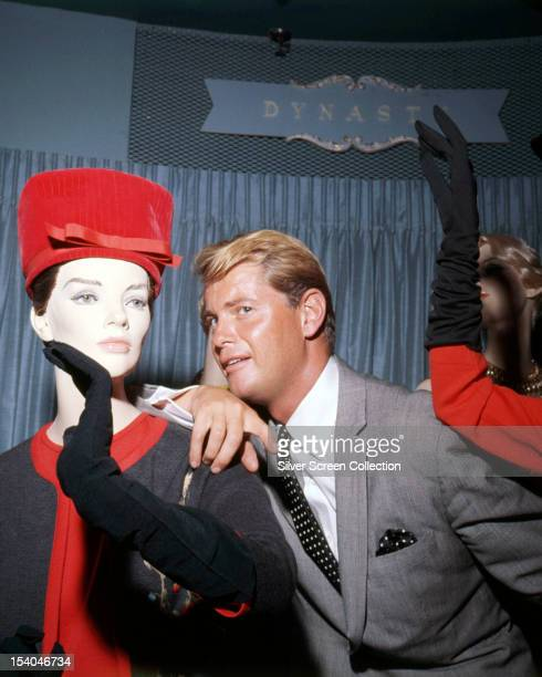 American actor Troy Donahue posing with a shop mannequin circa 1962