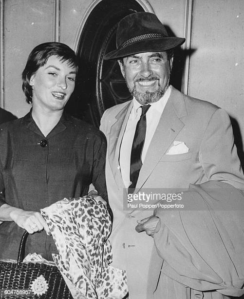 American actor Tyrone Power and his wife Deborah Ann Minardos arrive in London on their way to Spain to begin filming 'Solomon and Sheba' August 1958