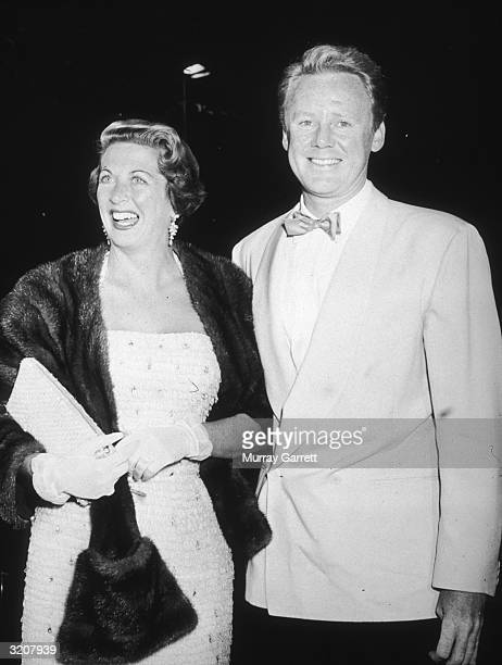 American actor Van Johnson and his wife Eve Abbott stand together and smile after arriving for a Damon Runyon Cancer Fund benefit at the Mocambo...