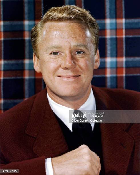 American actor Van Johnson posing in front of a tartan background circa 1955