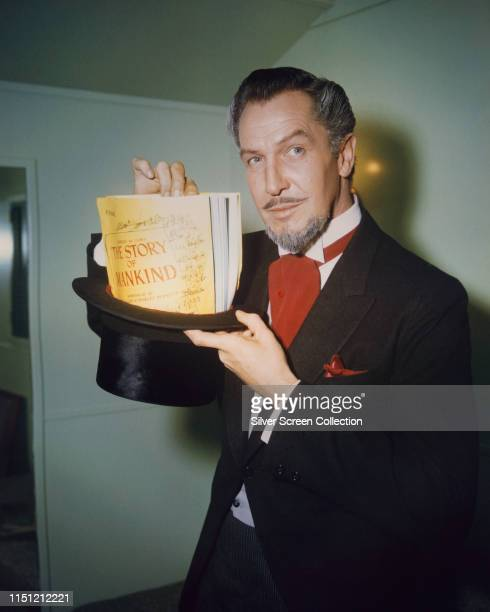 American actor Vincent Price as The Devil, aka Mr Scratch, in a publicity still for the film 'The Story of Mankind', 1957. He is holding a script for...