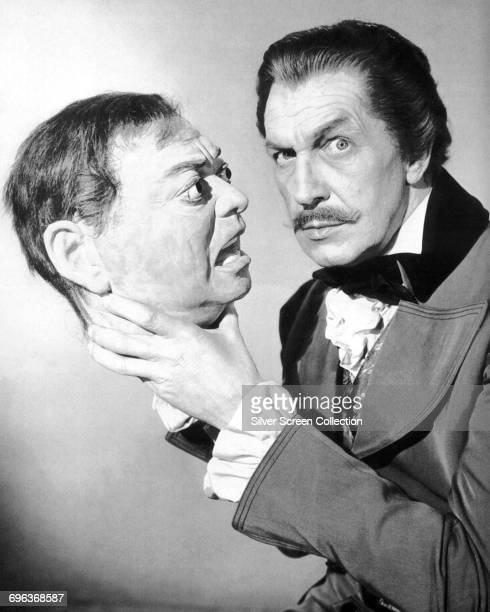 American actor Vincent Price holding the head of costar Peter Lorre in a publicity still for the film 'Tales of Terror' 1962 The film is based on the...