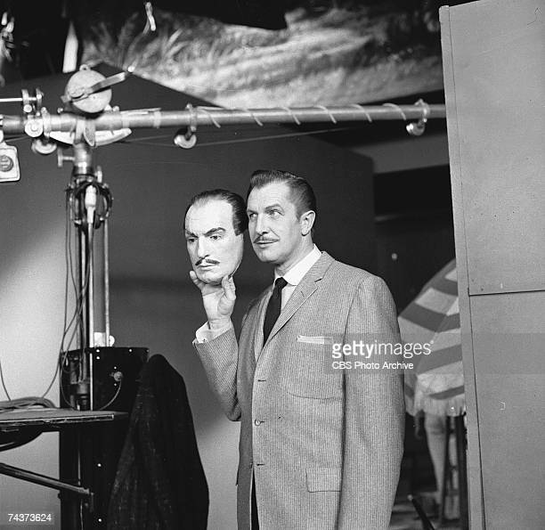 American actor Vincent Price holds up a mask of his own face backstage on the set of the 'Chrysler's Shower of Stars' television variety show May 9...