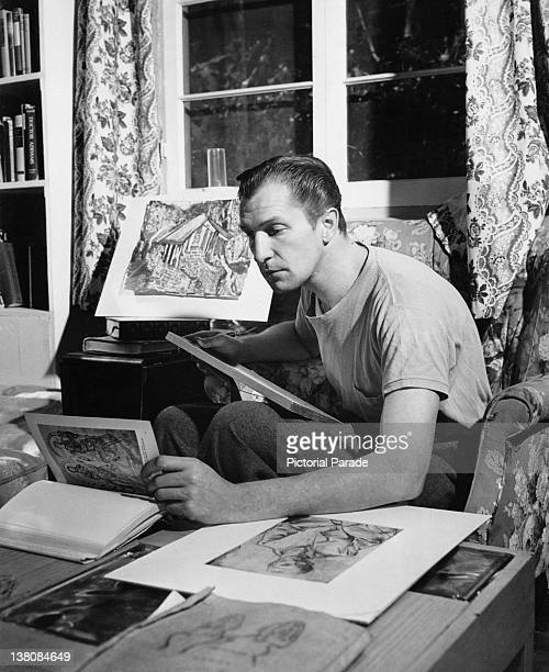 American actor Vincent Price looking through some of the artworks in his collection circa 1950