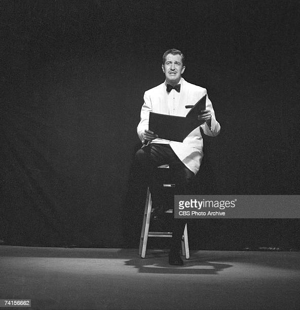 American actor Vincent Price sits on a stool and reads from an oversized book during a skit on 'The Red Skelton Show' May 13 1958