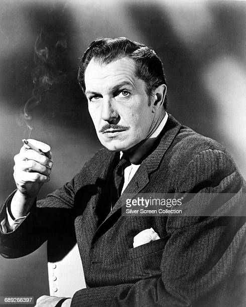 American actor Vincent Price smoking a cigarette circa 1955