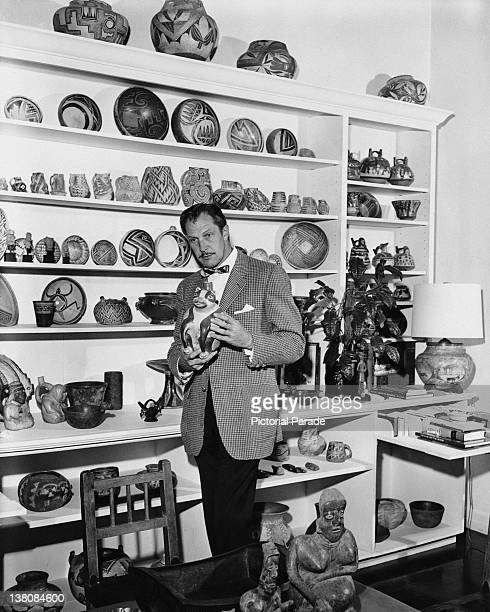 American actor Vincent Price with a display of ceramics from his art collection circa 1955