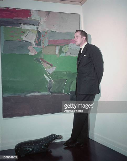 American actor Vincent Price with a painting from his art collection circa 1955