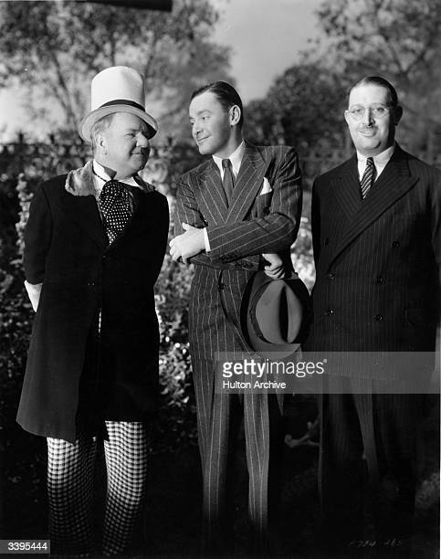 American actor W C Fields left with his friend Herbert Marshall during a break from filming 'Poppy' directed by A Edward Sutherland for Paramount