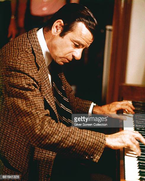 American actor Walter Matthau plays ragtime piano in the film 'Pete 'n' Tillie' 1972