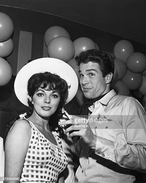American actor Warren Beatty with English actress and fiancee Joan Collins at a Hollywood charity event