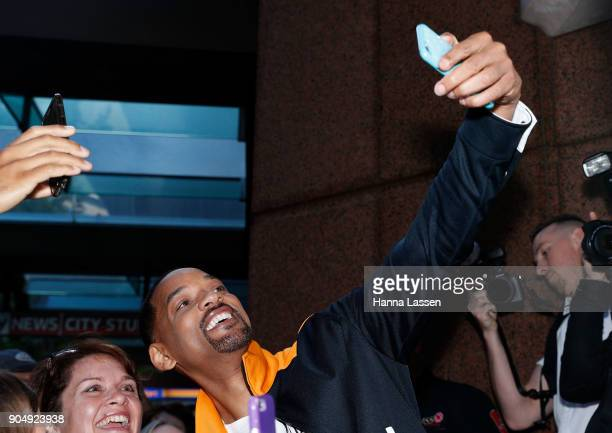 American actor Will Smith takes selfies with fans at Martin place ahead of his appearance on 'Sunrise' on January 15 2018 in Sydney Australia