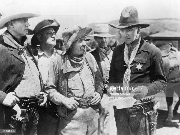 American actor William Boyd stars as town sheriff Hopalong Cassidy in 'The Eagle's Brood'